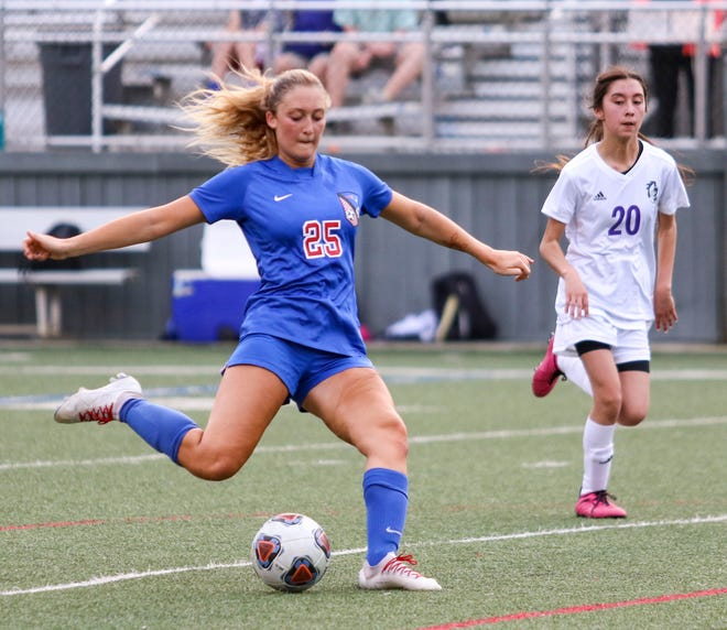 ACA midfielder Mallory Ballou (25) shoots the ball from outside the 18-yard box. ACA women's soccer defeated Holt by mercy rule 10-0 on March 26, 2021 [Photo/Hannah Saad]