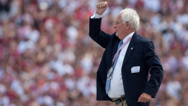 James Ferguson, a past director of the Million Dollar Band, leads the band in the national anthem before the Alabama vs. Florida Atlantic University college football game in Tuscaloosa, Ala. on Saturday, Sept. 22, 2012. (Staff file photo)