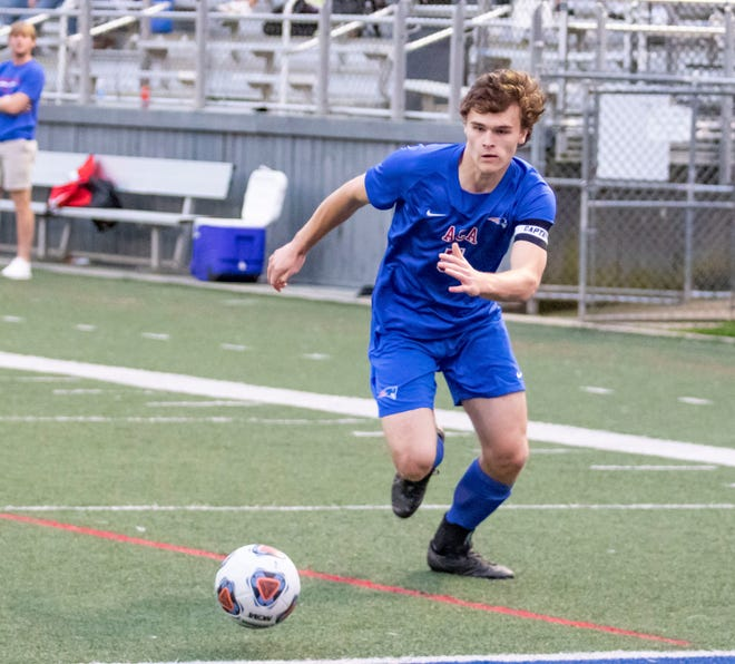 ACA forward Hudson Thrasher (5) chases the ball down. ACA men's soccer hosted Holt for an area matchup on March 26, 2021. [Photo/Hannah Saad]