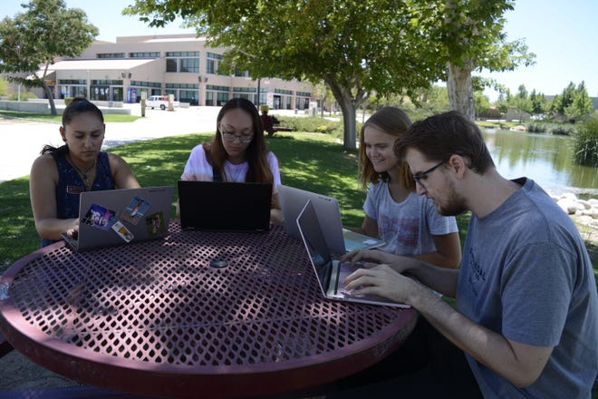 Victor Valley College students study on campus in 2019.