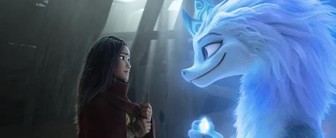"""Ray (voiced by Kelly Marie Tran, left) teams up with legendary water dragon Sisu (Awkwafina) in Disney's """"Raya and the Last Dragon."""""""