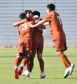 The Alice boys soccer team celebrates after scoring a goal during Friday's Class 4A bi-district match against Edinburg IDEA Quest at Alice Memorial Stadium.