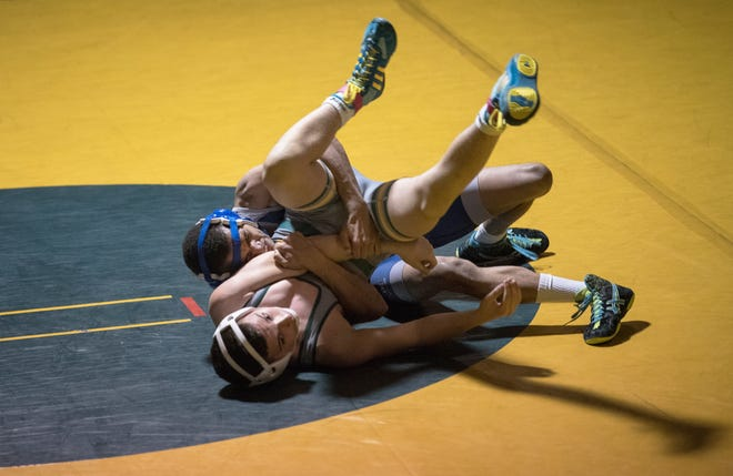Gateway/Woodbury's Marc Adams controls Audubon's Rocco Nocce during the 126 lb. bout of the wrestling meet held at Audubon High School on Friday, March 26, 2021.  Adams pinned Nocce to win the match.