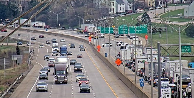 Kenton County dispatch says the northbound lanes of Interstates 71/75 that were closed at the 12th Street exit in Covington due to a crash and oil spill this morning are reopening.