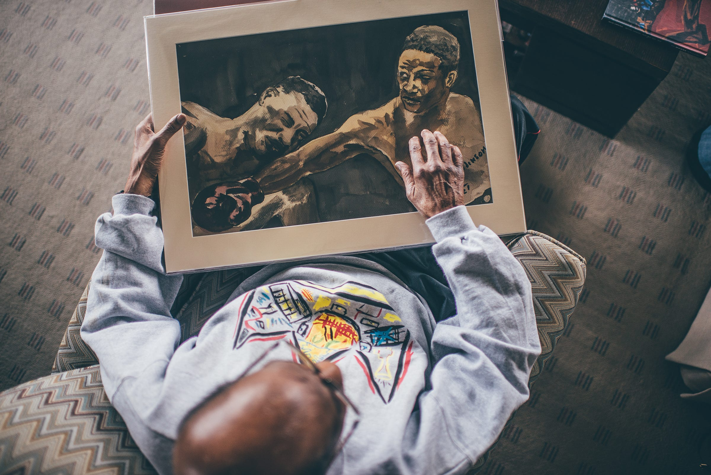 Donald Robinson holds artwork he created as a student at Cass Technical High School.