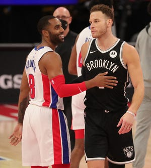 Detroit Pistons guard Wayne Ellington (8) and Brooklyn Nets forward Blake Griffin (2) talk after the game on Friday, March 26, 2021 at Little Caesars Arena in Detroit.