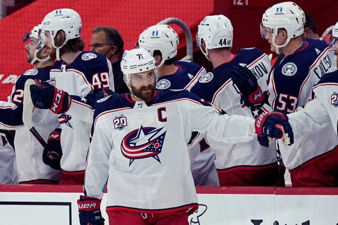 Columbus Blue Jackets left wing Nick Foligno greets teammates after scoring during the second period of an NHL hockey game against the Detroit Red Wings, Saturday, March 27, 2021, in Detroit.