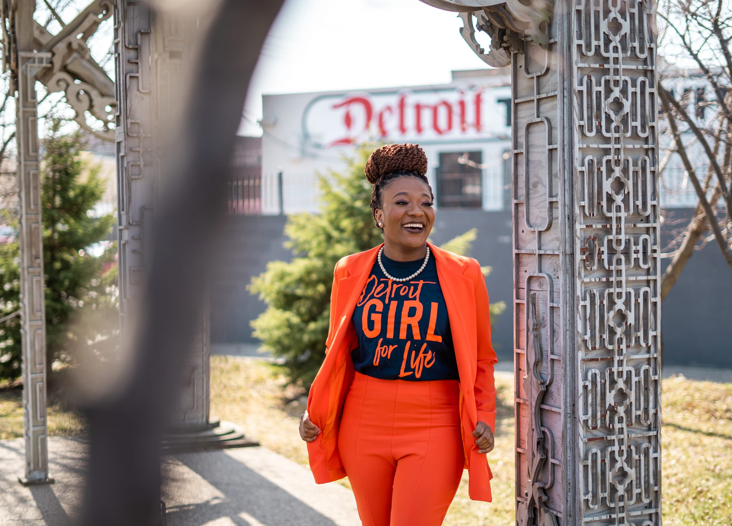 Detroit Is reporter Kyla Wright poses for a photo in the Artist's Village area of Detroit on Wednesday, March 17, 2021.