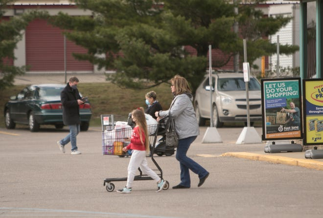 Shoppers come and go at VGs Grocery in Howell Friday, March 26, 2021. One in four households in Livingston County struggles financially, according to a new report.