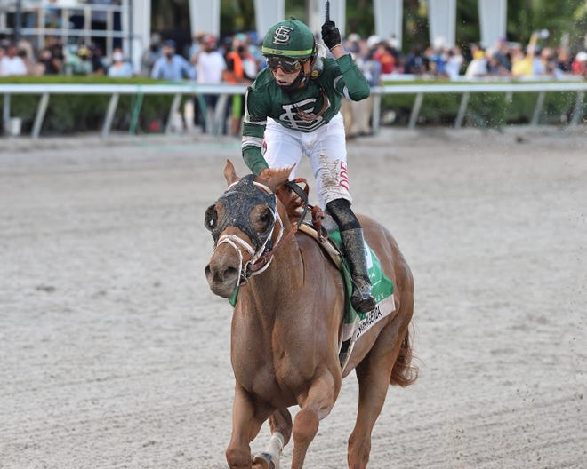 Known Agenda and jockey Irad Ortiz Jr. won the Florida Derby on March 27, 2021, at Gulfstream Park.