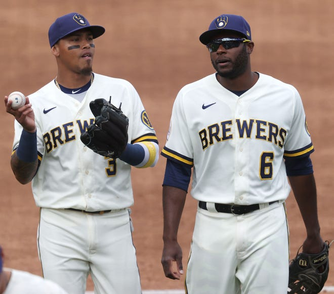 Orlando Arcia (left) and Lorenzo Cain chat as the head to the Brewers dugout during the middle of the fourth inning during the game against the White Sox.