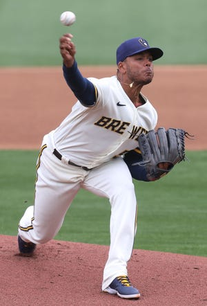 Brewers starter Freddy Peralta delivers a pitch during the first inning against the White Sox.