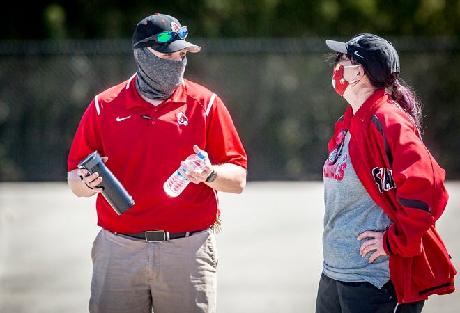 Josh Pawlus (left) has a conversation during a Ball State baseball game against Toledo at Ball Diamond Saturday, March 27, 2021.