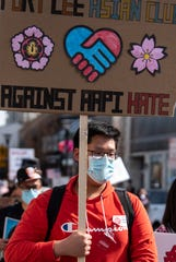 The Youth Council of Fort Lee hosts a peaceful march against Asian hate in Fort Lee on Saturday March 27, 2021. Alex Lee, 16, marches against Asian hate.