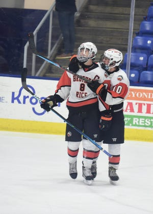 Brother Rice sophomore Peter Rose celebrates senior captain Alec Hamady after his game-winning goal.