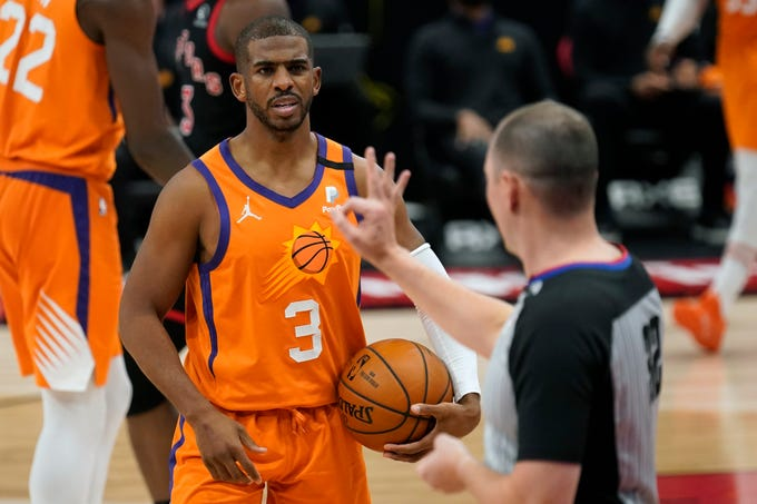 Phoenix Suns guard Chris Paul (3) reacts to a foul call during the second half of an NBA basketball game against the Toronto Raptors Friday, March 26, 2021, in Tampa, Fla. (AP Photo/Chris O'Meara)
