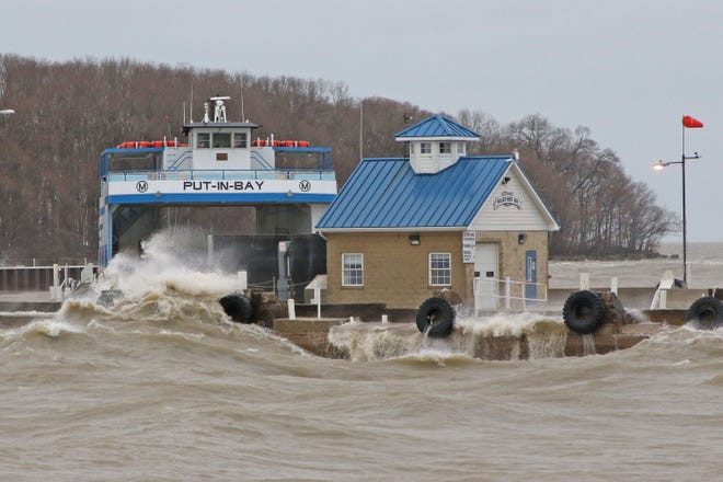 Waves crash on the Miller Boat Line dock during a strong storm. Morning trips were canceled on Friday due to high winds and dock conditions.