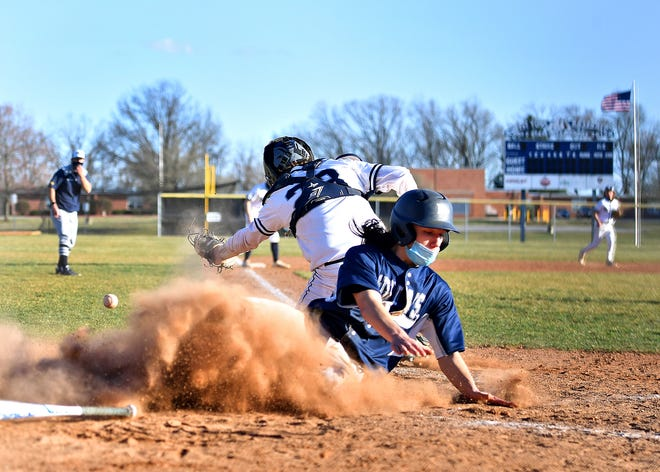 Dallastown's Cam Flinchbaugh, front, scores a run while West York's Brayden Harris looks for the ball during baseball action at Sunset Lane Park in West Manchester Township, Friday, March 26, 2021. Dallastown would win the game 8-6. Dawn J. Sagert photo