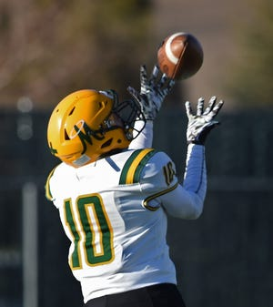 Bishop Manogue's Cort Ballinger reaches for a catch for a touchdown against Damonte Ranch during a game at Damonte Ranch High School on March 26.