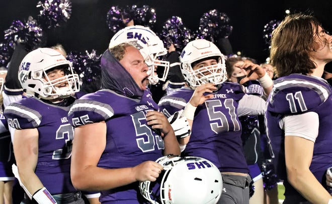 Shasta players celebrate after winning the River Bowl 57-7 over Enterprise on Friday night, March 26, 2021.