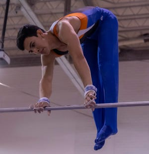 San Angelo Central High School's Emiliano Hinojos performs on high bar at the District 2-6A Gymnastics Championships in Odessa on Friday, March 26, 2021.