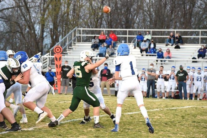 Wilson Memorial's Marshall Hubbard tries to get to Foort quarterback Shannon Knicely Friday night, March 26. Wilson Memorial beat Fort Defiance 21-8 in the First Responders Bowl.