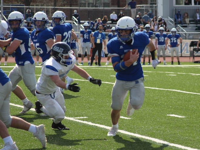 Bronxville's Henry Donohue (24) avoids a defender during the Broncos' 48-7 win over Dobbs Ferry on March 27, 2021.