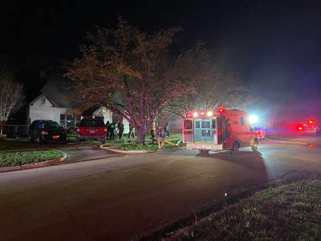 Wichita Falls firefighters worked the scene of a two-alarm fire on Kessler Avenue Friday night
