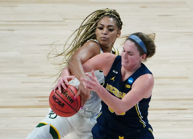 Baylor Lady Bears guard DiJonai Carrington (21) battles for the ball with Michigan Wolverines forward Emily Kiser (33) in the Sweet 16.