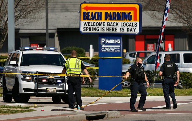 Virginia Beach police put up police tape across Pacific Ave. at the Oceanfront on Saturday, March 27, 2021, morning after a fatal shooting the night before in Virginia Beach, Va.