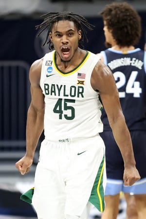 Davion Mitchell of Baylor celebrates after a play against Villanova in the second half of their Sweet 16 game at the 2021 NCAA men's tournament at Hinkle Fieldhouse.
