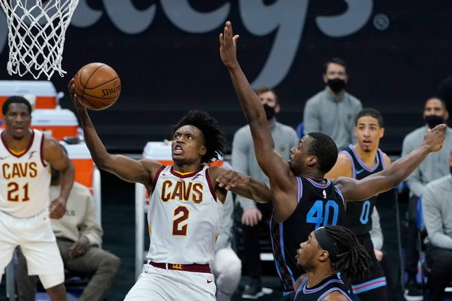 Cleveland Cavaliers guard Collin Sexton (2) shoots against Sacramento Kings forward Harrison Barnes (40) during the first half of an NBA basketball game in Sacramento, Calif., Saturday, March 27, 2021. (AP Photo/Jeff Chiu)
