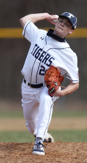 Twinsburg starting pitcher Henry Holman delivers a pitch against Woodridge in the second inning at Dodge Field on Saturday. Twinsburg defeated Woodridge 10-0 in five innings. [Mike Cardew/Beacon Journal]