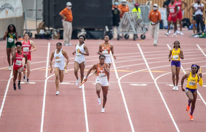 Texas' Kynnedy Flannel, center, shown running the 400-meter relay during this year's Texas Relays, led the Longhorns to the women's team title at last weekend's Big 12 outdoor championships in Manhattan, Kan. The senior earned the Big 12's High Point Award for the second straight year by winning the 100, 200 and anchoring the winning 400-meter relay.