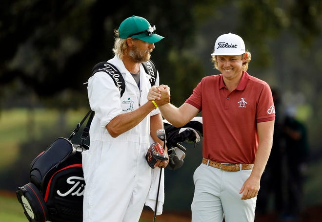 Cameron Smith celebrates a shot with his caddie Matthew Tritton during the final round of the Masters golf tournament at Augusta National Golf Club last November. Mike Holahan/The Augusta Chronicle