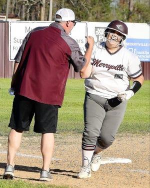 Merryville senior Laken Disatell rounds third base after hitting her first career homer on Senior Night. The Lady Panthers beat East Beauregard, 17-1.