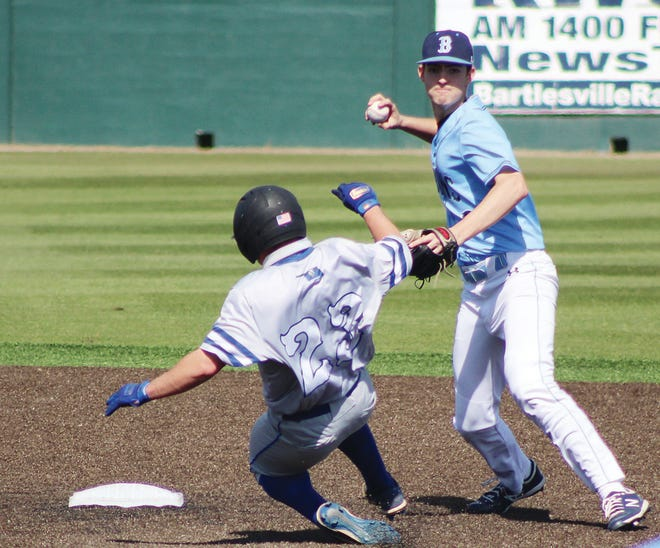 Bartlesville High shortstop Jakob Hall, right, looks to complete a doubleplay during Saturday's battle against Sapulpa High.