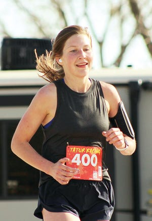 Emma Cone blazes along in second place overall during Saturday's K-Life 10K Run the Ville in Bartlesville.