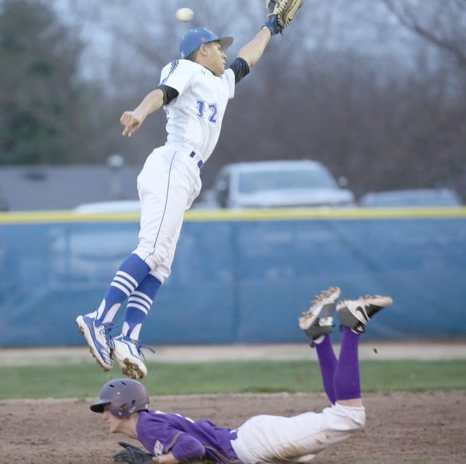 Boonville JV shortstop Caidyn Hazel leaps high for the ball on a throw down to second in the first inning Friday night against Hallsville. The Pirates JV defeated Hallsville 5-2.