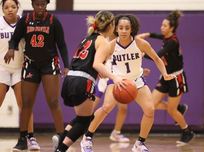 Butler's Skyla Knight (1) guards an Allen County defender in Saturday's win