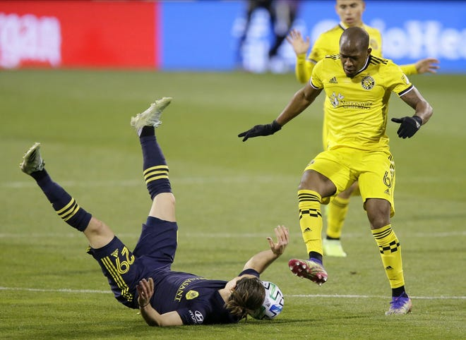 Nashville midfielder Alex Muyl falls while defended by Crew midfielder Darlington Nagbe during an MLS playoff match on Nov. 29. Nagbe has been part of three MLS championship teams.