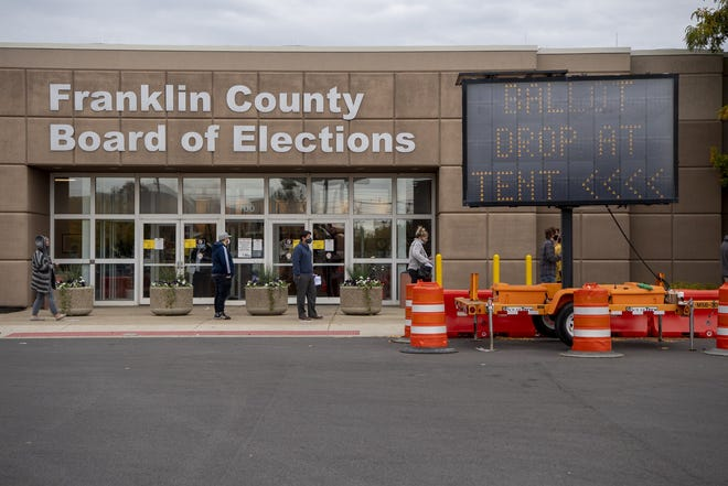 Voters await entry into the Franklin County Board of Elections on Morse Road on Oct. 15, 2020.