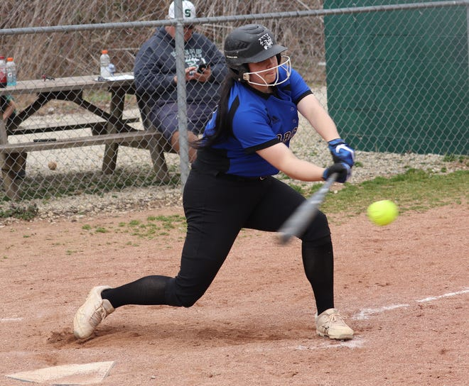 Cambridge junior Presley Dodd (27) connects for an RBI triple during Saturday's 7-0 opening day softball win over Shenandoah on Saturday afternoon.