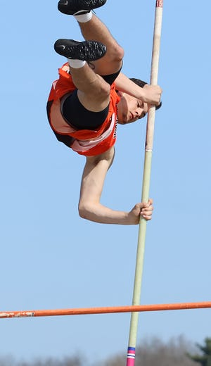 Meadowbrook's Hunter Eubanks clears the bar in boys' pole vaulting during the track meet at Meadowbrook High School Saturday morning. Eubanks won the event with a best effort of 11-06.