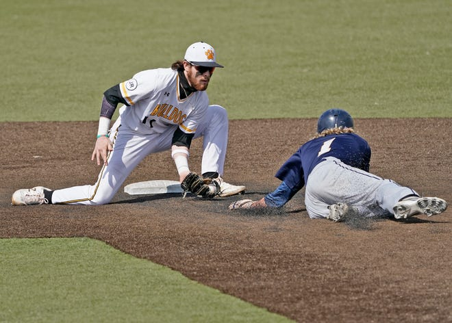 Adrian College's Brady Wood, left, tags out a Trine baserunner attempting to steal second base during Saturday's doubleheader at Nicolay Field.