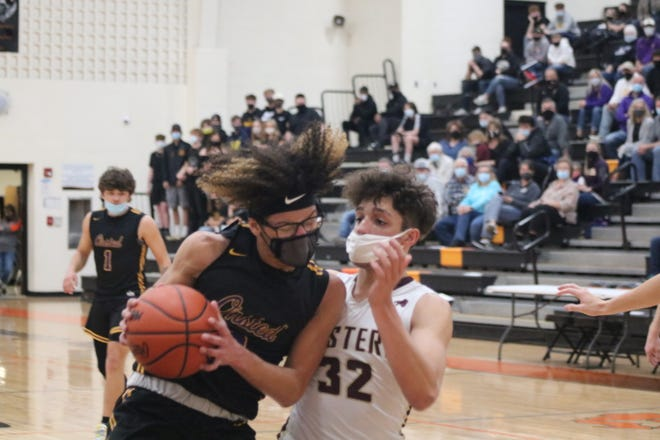 Onsted's Dayton Henagan drives to the basket during Saturday's Division 2 district final against Parma Western at Jonesville.