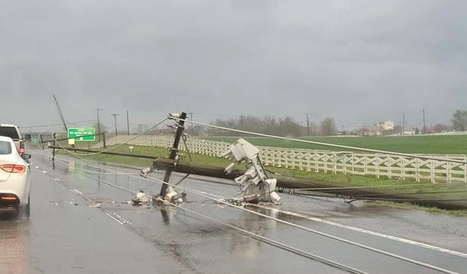 A utility pole snapped along Highway 31 near the GM plant entrance in Spring Hill due to straight line winds on March 27, 2021.