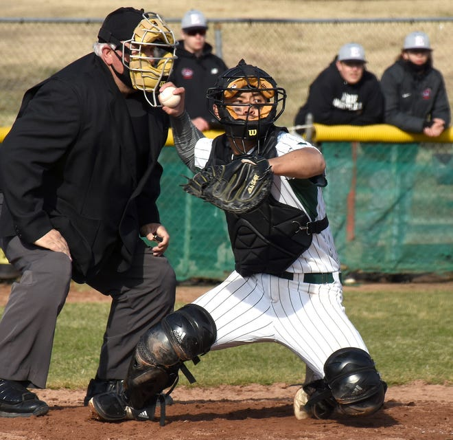 Herkimer College catcher Yuzuki Okamura tries to pick an Erie Community College runner off at first base during the second game of a Saturday, March 27, 2021, baseball doubleheader at Veterans Memorial Park in Little Falls, New York.