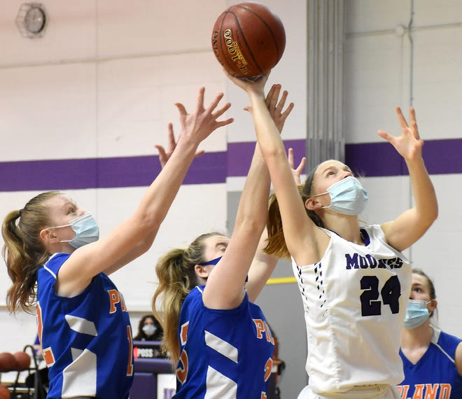 Olivia Lindsay (24) grabs a rebound for Little Falls during the first quarter of Saturday's game against Poland.