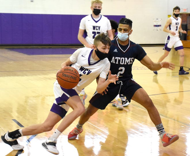 West Canada Valley Indian Jaeden Beam drives against the Utica Academy of Science's Dekwan Grant (2) during the second half of Saturday's game.